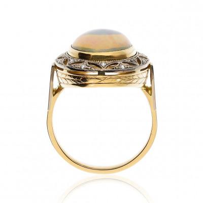 Pierścionek złoty z okazałym opalem 4,42 ct i brylantami 0,11 ct Si/H