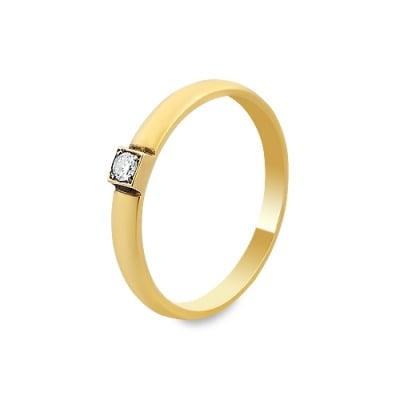 Pierścionek wykonany ręcznie w żółtym i białym złocie z brylantem 0,05 kt.